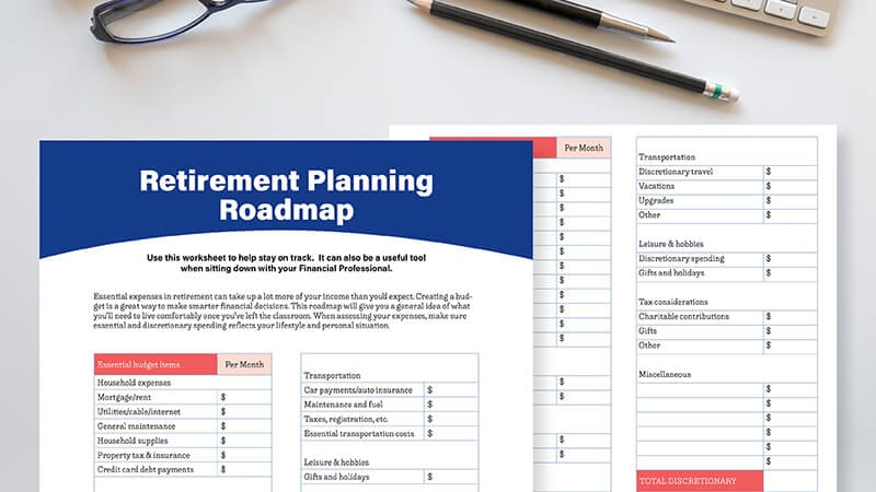 close up of a retirement planning worksheet on a white desk with a pair of eyeglasses and pencils