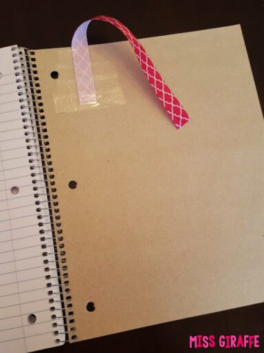 Attach ribbon to the back of a notebook for students to remember where they left off