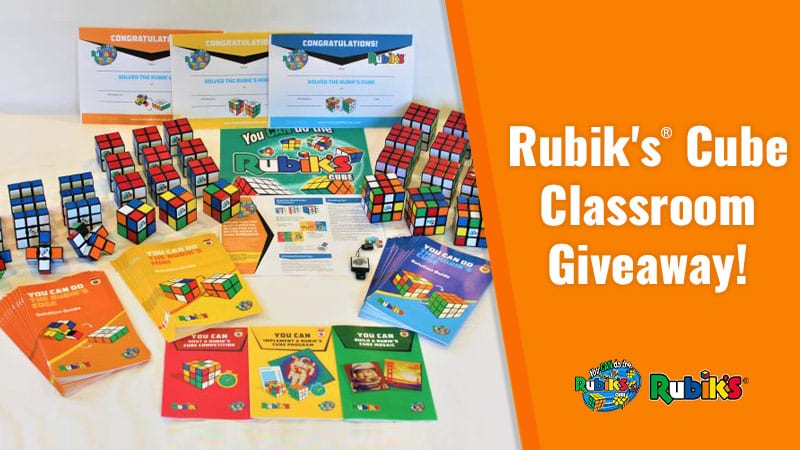 Rubik's Cube prize pack with Rubik's Cube Classroom Giveaway on orange background