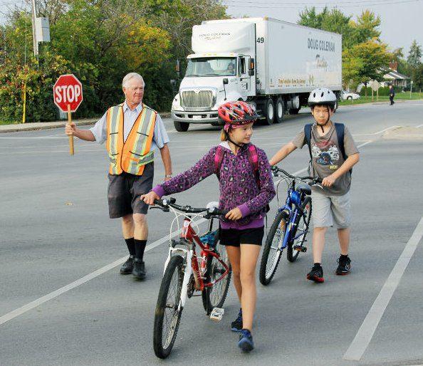Children on bikes crossing at the cross walk