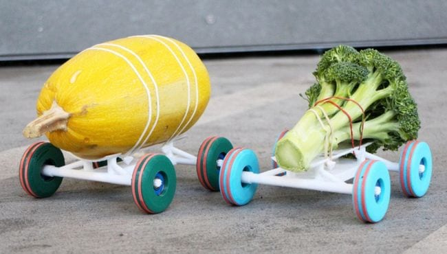 Simple 3-D printed race cars with vegetables strapped to them (Science Experiments for High School)