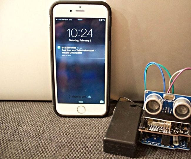 Simple electronic burglar alarm with a cell phone