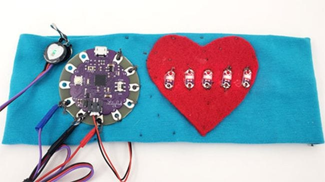 DIY heart rate monitor made from blue fabric and a red heart