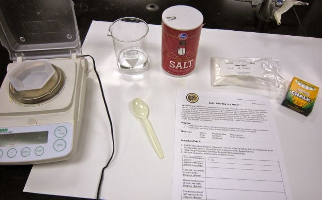 Supplies needed for mole experiment, included scale, salt, and chalk