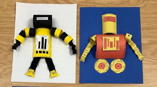 Colorful paper robots mounted on construction paper