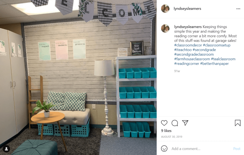 Simple reading corner in a classroom with shelving and milk crates turned upside down to make a seat
