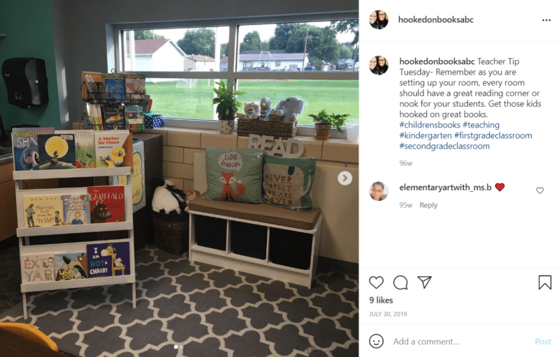 Book nook by a classroom window with books and seating