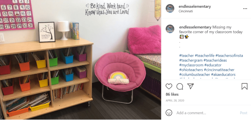 Classroom reading corner with shelving and a pink chair