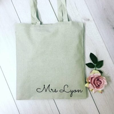 Green tote with teacher name at bottom