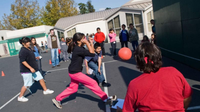 Students playing wall ball at school recess.