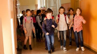 several kids in a school hallway