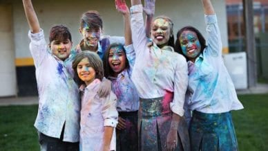 group of students with colorful paint on their faces and clothing - motivating students
