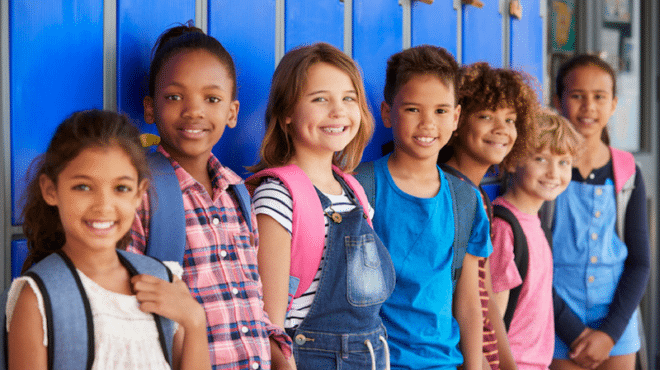 Elementary students standing in front of lockers - - Alternative to Suspension