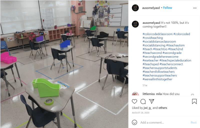 Socially-distanced seating arrangements created with tape on the floor in classroom