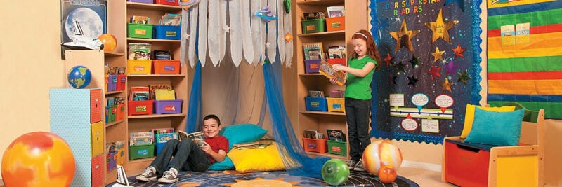 Brightly colored classroom library nook decorated with space theme