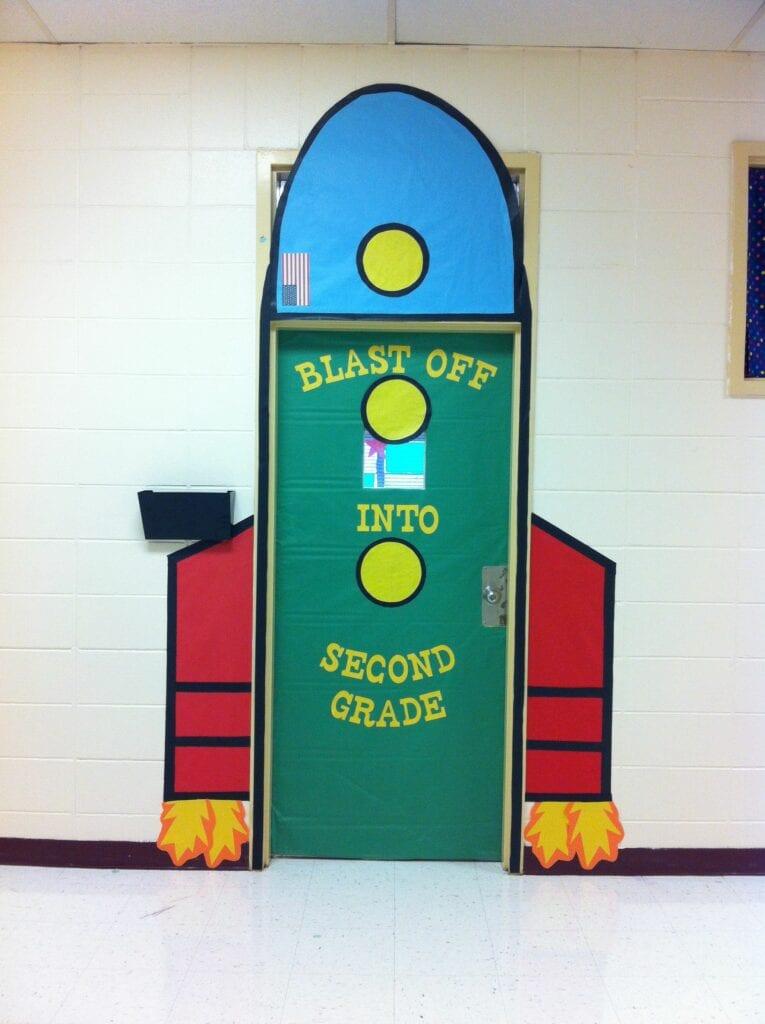 Rocket classroom door decor ideas for space theme