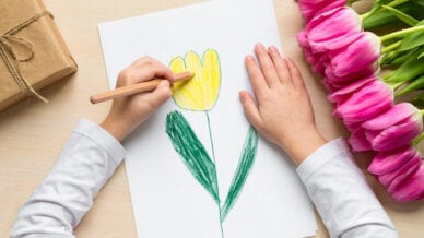 Boy drawing a flower -- spring poems for kids