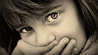 close up of young girl who experienced trauma