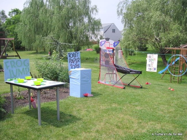 Backyard carnival with games like frog jump, toilet paper toss, and basketball (Staycation Activities)