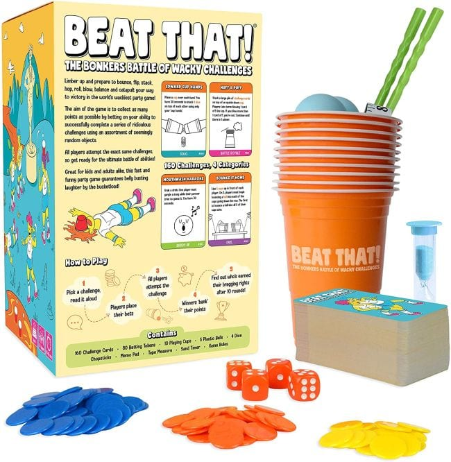 Family game called Beat That! with cups, dice, chips, and more