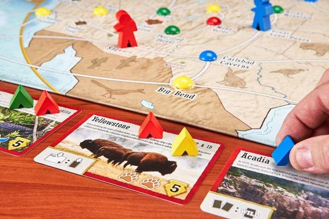 Board, cards, and markers for the game Trekking the National Parks