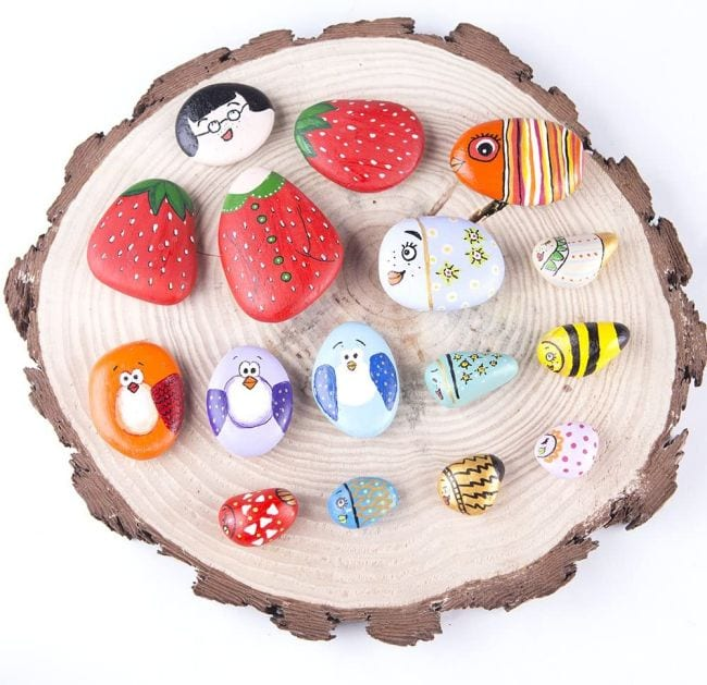 Collection of rocks painted like strawberries, fish, birds, and more (Spring Break Activities)