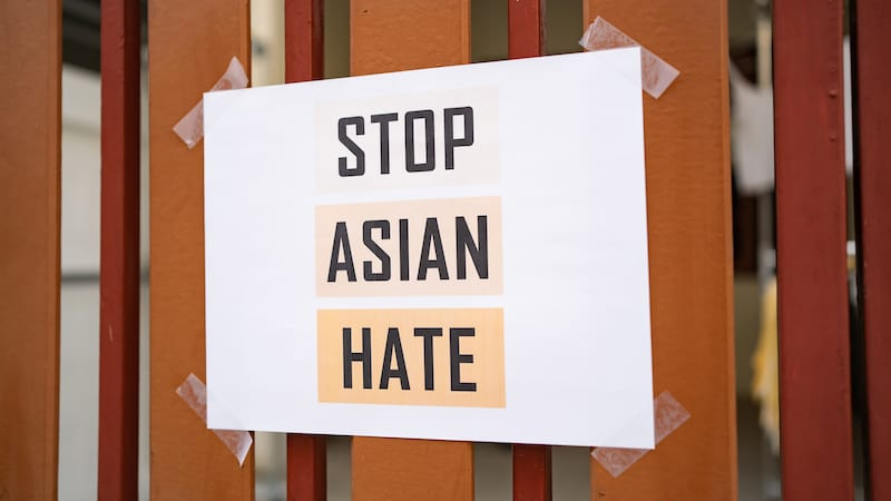 Stop Asian Hate sign attached on the house fence