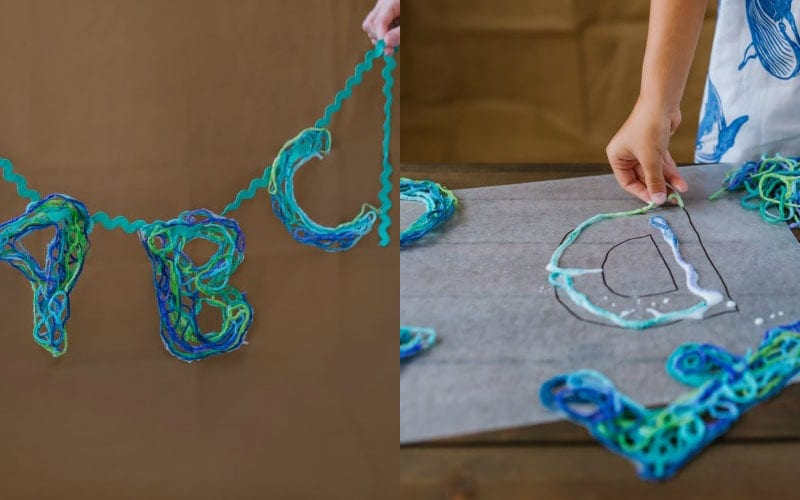 Blue and green letters created by dipping yarn in glue and laying it on wax paper