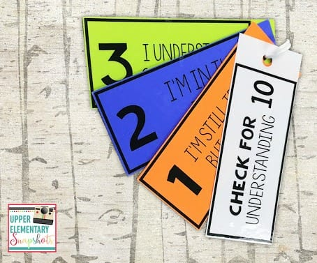 a set of cards with numbers 1-3 for students to use to check for understanding
