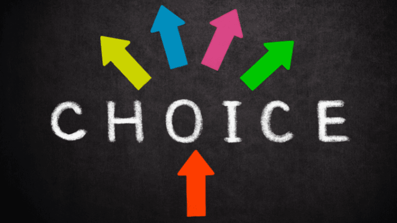 """Black background with the word """"choice"""" written in the middle in white chalk font with colorful arrows pointing out in different directions from the word"""