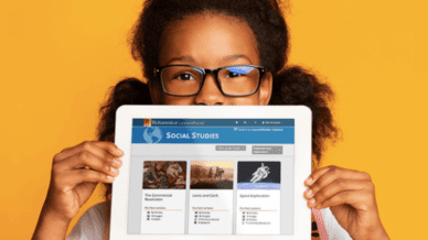 African American girl wearing glasses, holding iPad summer school resources from Britannica LaunchPacks