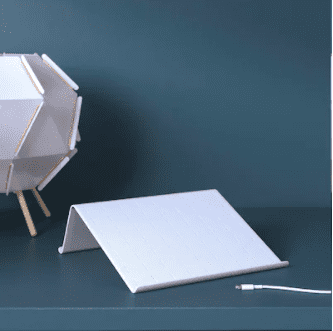 white stand for a tablet with charger