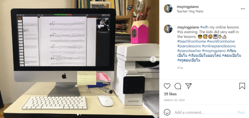Apple computer monitor screen with sheet music on a desk