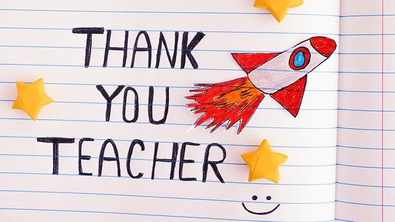 Thank you teacher written on a piece of paper.