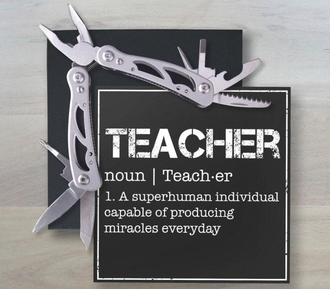 Multi Tool with a card defining teacher as a superhuman individual capable of producing miracles every day