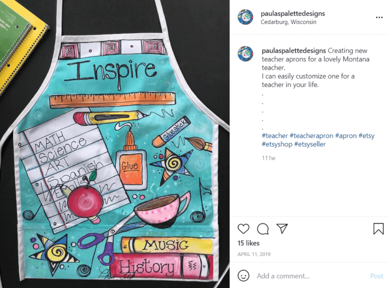 Laid out teacher apron with the word Inspire across the top of the apron and miscellaneous educator images on it
