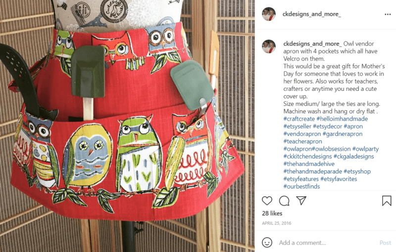 Teacher apron with cartoonish owls and pockets with spatulas on a mannequin
