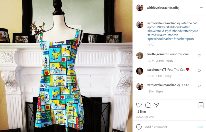 Pete the Cat patterned material teacher apron on mannequin in front of a fireplace with mirror