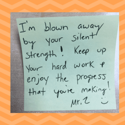 Teacher uses a sticky note to send daily affirmation to students.