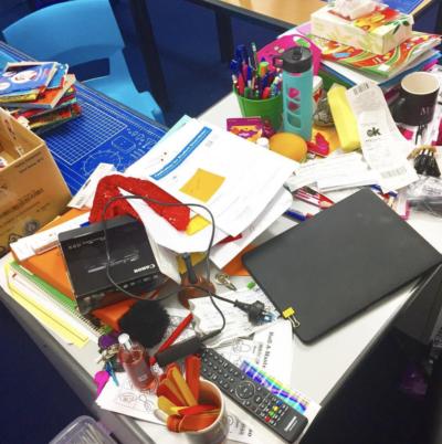Cluttered teacher desk
