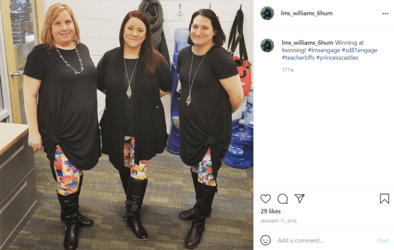 Three teachers wearing the same outfit consisting of black knee high boots
