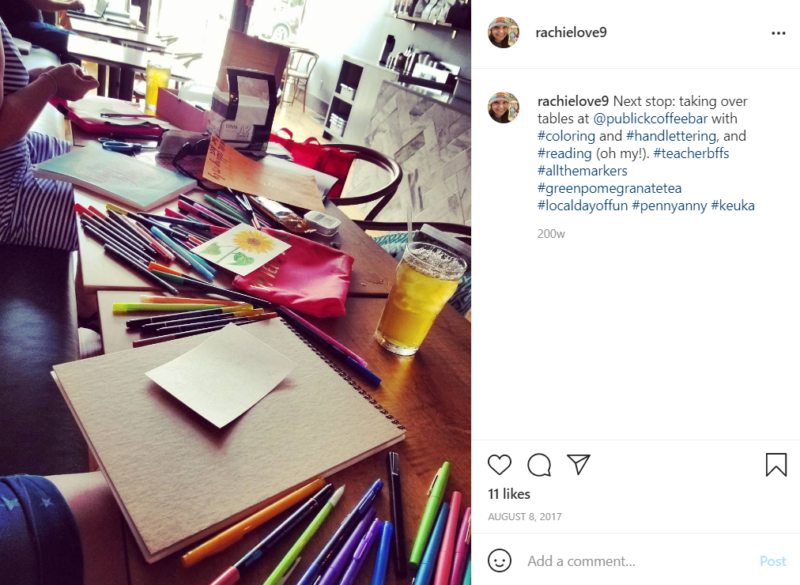 Colored pencils and paper strewn across the table at a local coffee shop