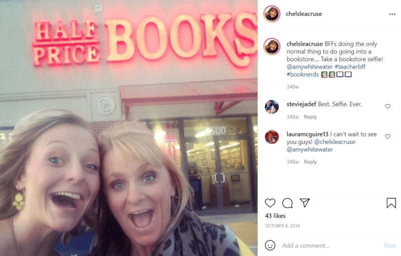 """Two teachers happily pose outside of a store named """"Half Price Books"""""""