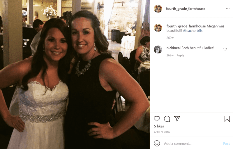 Two teachers pose at a wedding reception and one is the bride