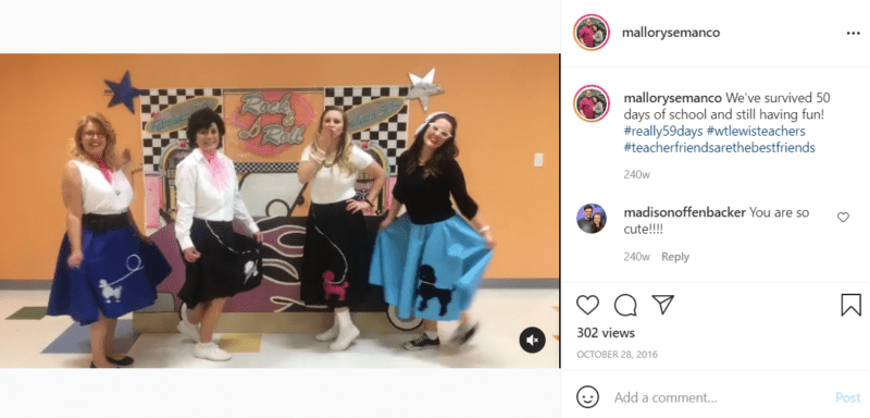 Four teachers pose in front of a 50's rock-n-roll Grease backdrop