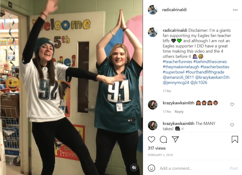 Two teachers posing in Philadelphia Eagles jerseys in classroom