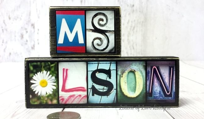 Letters in a variety of styles mounted on black wood blocks to spell Ms Olson (Teacher Name Signs)