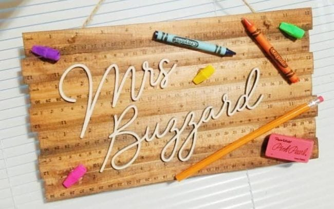 Sign made of wooden rulers with crayon decorations and the name Mrs. Buzzard (Teacher Name Signs)