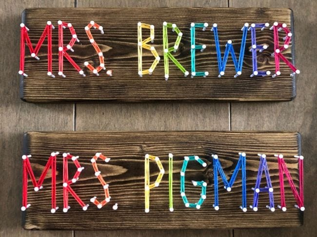 Teacher names spelled out in colorful string strung between nails (Teacher Name Signs)