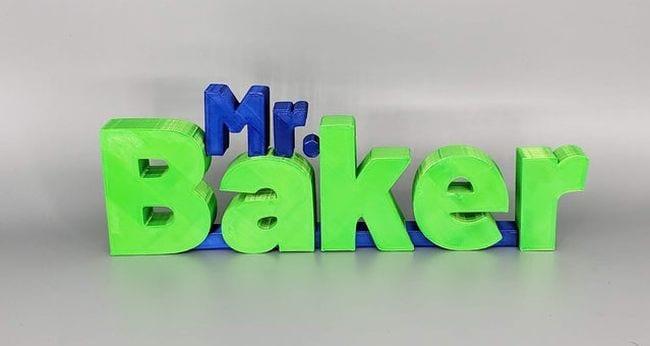 Wood blocks letters in blue and green spelling Mr Baker